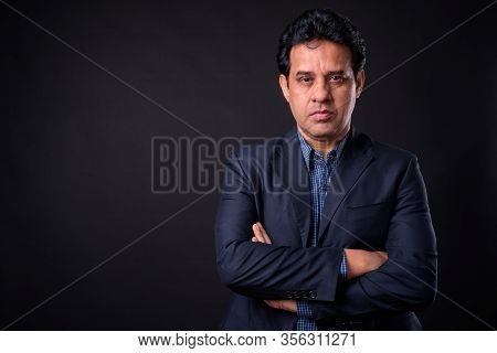 Portrait Of Mature Handsome Indian Businessman In Suit