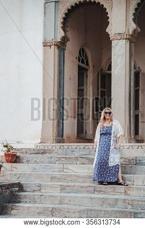 Beautiful Blonde Woman Stands On The Steps Of The Monsoon Palace In Udaipur India
