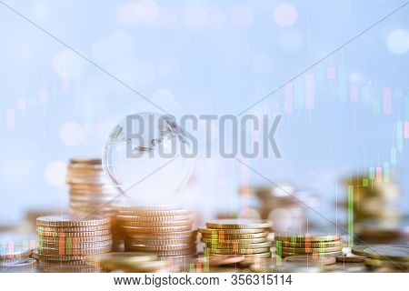 Coins Stack And Financial Stock Market Graph, Savings Money And Investment For Business Concept, Dig