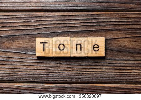 Tone Word Written On Wood Block. Tone Text On Wooden Table For Your Desing, Concept