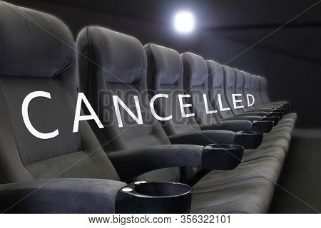 Event Cancelled Background. Word Cancelled On Empty Seats Of Cinema, Theater, Conference Hall. Festi
