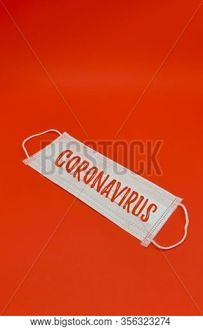 Medical Mask, Prevention Of Influenza. Protective Mask For Health Care Use On Red Background. Medica