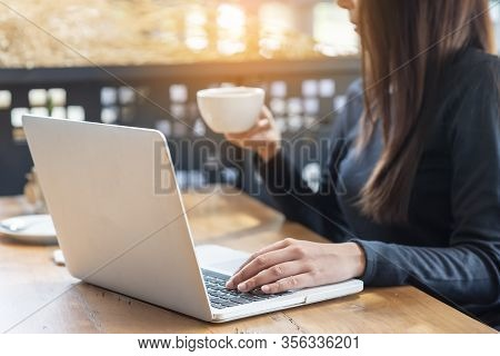 Business Woman Working On Laptop And Drinking Coffee At Home Office,student Typing Report And Resear