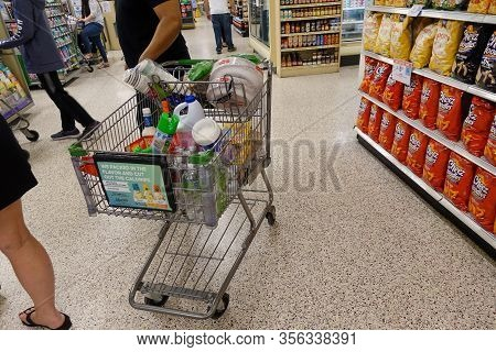 Orlando, Fl/usa-3/15//20: A Typical Grocery Cart Filled With Food And Disinfectant Cleaning Supplies