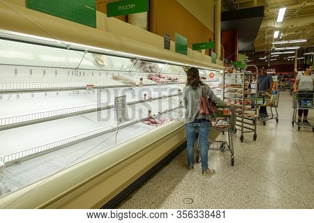 Orlando, Fl/usa-3/14//20: Empty Meat Display Shelves At A Publix Grocery Store Due To The People Pan