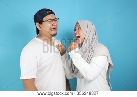 Muslim Couple Having Conflict, Husband Afraid To His Wife Concept
