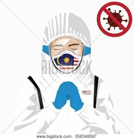 Covid-19 Or Coronavirus Concept. Malaysian Medical Staff Wearing Mask In Protective Clothing And Pra