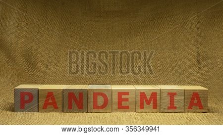 Wooden Cubes With Red Word Pandemia On Sackloth Background. Pandemia And Covid-19 Concept.