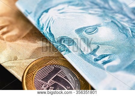 Banknotes Of One Hundred Reais And Fifty Reais, With Coins Of One Real, Money From Brazil. Isolated