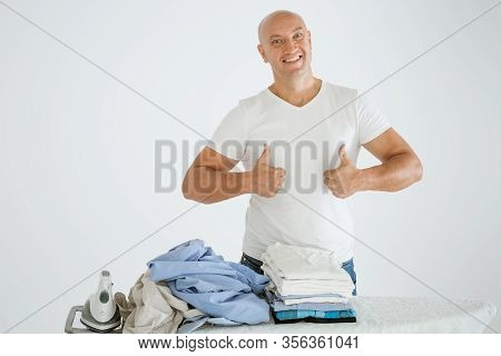 A Man On A White Background With An Ironing Board, There Is An Iron And There Are Ironed Things And