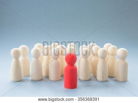 A Concept Image Of A Person Standing Out From A Crowd As A Leader Or Inspirational Teacher Amongst M