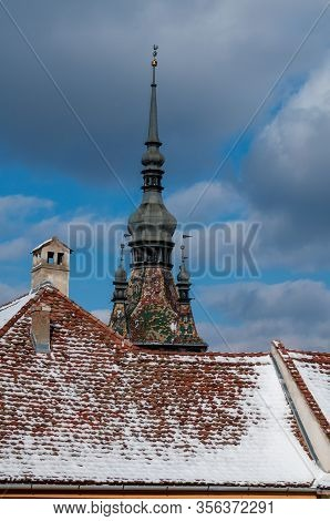 A Rooftop And A Church Steeple. Rooftop Covered With Snow. Winter Scene.