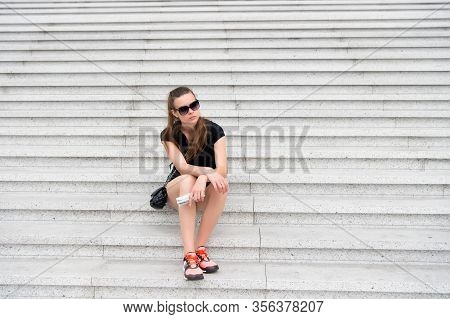 Traveling Alone. Solo Female Traveler. Tired Traveler Sit On Steps. Sexy Woman Rest On Stair. Leisur
