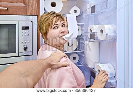 Woman With Toilet Paper By The Refrigerator Was Caught Her Husband During Nightly Meal. Prank Of Ove