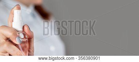 Female Hand Holds A Sanitizer Gel Plastic Bottle For Protection Against Coronavirus, Banter On Hand