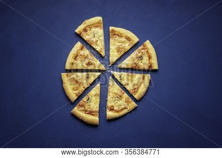 Pizza Quattro Formaggi Made At Home. Sliced Pizza On Blue Background, Above View. Italian Pizza Made