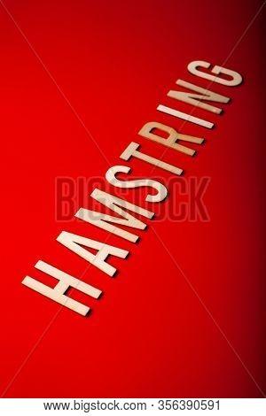 hamstring norwegian word text wooden letter on red background coronavirus covid-19