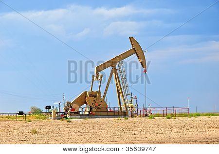 Large Pump Jack Pulling Crude Oil Up