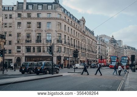 London, Uk - March 06, 2020: Black Cabs, Buses And People On Regent Street, A Major Shopping Street
