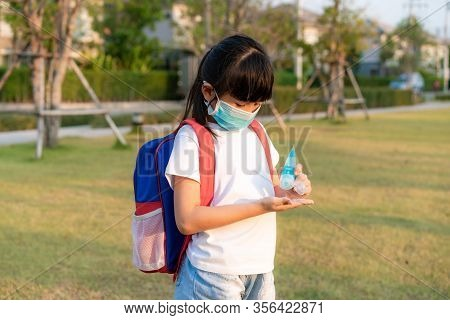 Asian Child Girl Using Alcohol Antiseptic Gel, Prevention, Cleaning Hands Frequently, Prevent Infect