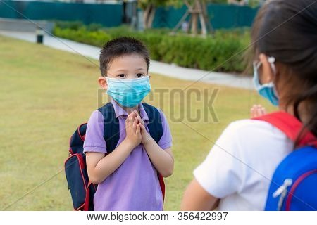 Pay Respect Is New Novel Greeting To Avoid The Spread Of Coronavirus. Two Asian Children Preschool F