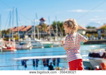 Child Watching Yacht And Boat In Harbor. Yachting Sport For Family With Kids
