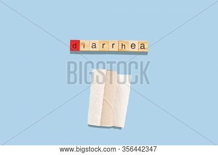 Diarrhea Concept: The Word Diarrhea Made With Wooden Tiles On A Blue Background D Is Red And Toilet