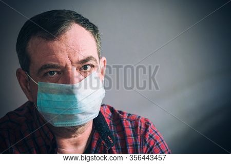 Close-up of a mature man in a medical mask