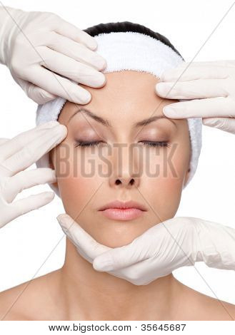 Young girl decides to try a plastic surgery to be more beautiful, isolated, white background