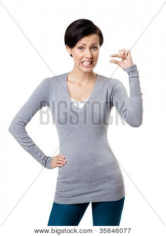 Dissatisfied woman gestures small amount, isolated on white
