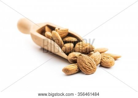 Dried almonds nuts in scoop isolated on white background.
