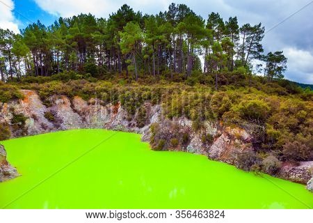 New Zealand, North Island. Devil's Bath with bright green water. Volcanic Valley Waimangu, Wai-O-Tapu. The unique geothermal area of Rotorua. Extreme, exotic and photo tourism concept