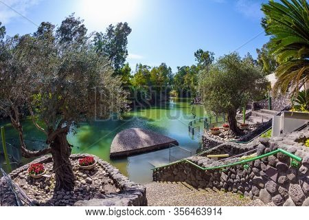Yardenit, Israel. The exit of the Jordan River from Lake Galilee. The venue of the symbolic ceremony of baptism for believers of the Greek Orthodox Church and Catholics. Religious tourism concept
