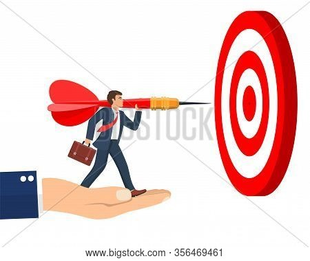 The Hand Is Lifting The Businessman To Reach His Goal. Businessman Aim Arrow To Target. Goal Setting