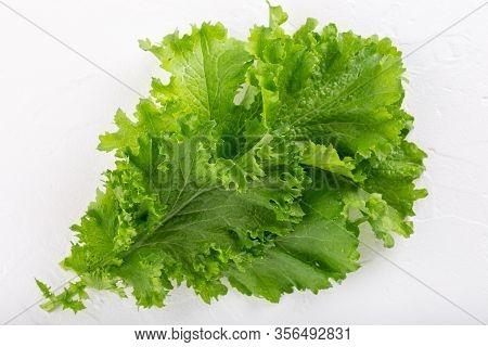 Mustard Leaves On White Background. Сurled Leaf Mustard, Brassica Juncea.  Close-up.