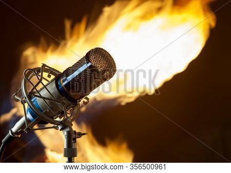 Metal  Microphone On A Fire On A Dark Background Photo