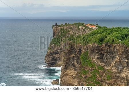 Panoramic View Of Uluwatu Temple Seen From Karang Boma Cliff Before The Storm In The South Of Bali,