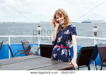Standing Woman On Ship Deck With Mobile Telephone