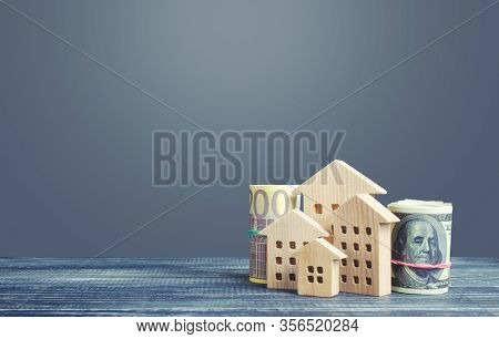 Residential Buildings And Dollar Euro Money. House Maintaining Cost, Utility Bills. Property Valuati