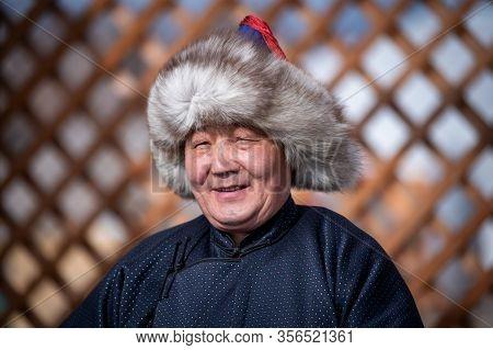 Naryn-Atsagat zone, near Oulan Oude (ulan ude), Siberia, Russia - Mars 09, 2020 : Portrait of buryat man in traditional costume. Buryatia republic, Siberia, Russia.