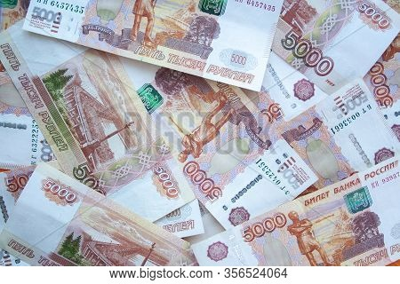 Rouble 5000 Banknotes Background Top View. Texture Of Banknotes Russian Money