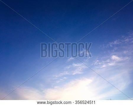 Evening Purple Sky Background. The Sky Before The Night. Beautiful Clouds On Evening Sky Backdrop