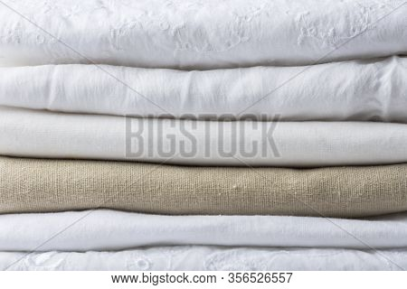 Stack Of White And Beige Pure Organic Cotton And Linen Folded Fabric. Clothing Laundry Home Textile