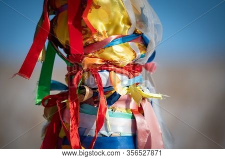 Sacred Pillars With Tied Ribbons On Cape Burhan Of Olkhon Island. Buryat Traditions. Shamanistic And