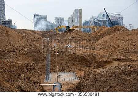 Excavator At Construction Site During Laying Sewer And Main Reticulation Systems. Civil Infrastructu