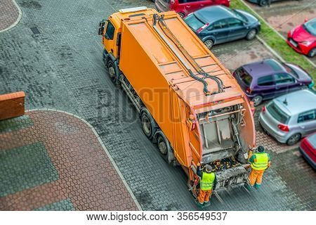 Urban Recycling Waste And Garbage Services . Orange Truck, Garbage Removal .