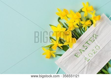 Coronavirus Covid 19 Quarantine Concept. Easter Spring Narcissus Flowers With Face Medical Mask On B