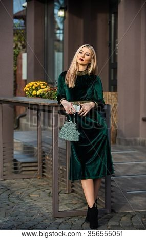 Sexy Beauty. Glam Clutch Accessory. Elegant Woman In Green Velour Dress. Glamour Velvet Textile. Sex
