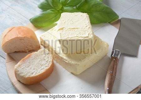 Butter. Slice Of Butter With Basil And Other Herbs