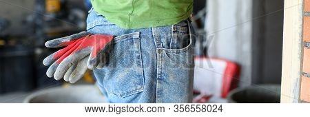 Work Clothes On Builder, Rubber Gloves Your Pocket. Gloves Eliminate Risk Damage To Skin Hands In Ha